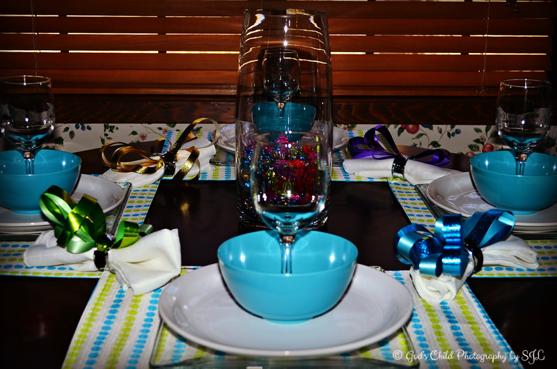 "Monday, March 17, 2014   ""RIBBONIZED"" Theme   ""Each new day, a gift to be opened, sunrise slowly unties it's ribbon of hope."" ~ Unknown Author  The debut of our March, 2014 table setting........  I didn't have much time to get creative with this table setting. I used selected ribbons from our January (2014) table setting and created bows. All other décors have been used with previous table settings. I applied one of PicMonkey's ""effects"" to this one.  ""Ribbons bring an almost ethereal quality to decorating, and they can be seen on decorating projects as varied as package wrapping to table decoration. Their satiny sheen and rich, soft texture add a special elegance to a fancy table. Because of the variety of ribbon available on the market, it doesn't matter what season you're decorating your dinner for -- there's a ribbon and decorating technique that will make your table beautiful and memorable to your guests."" ~ Reprinted text from here: http://www.ehow.com/how_8183007_decorate-table-ribbons.html#ixzz2pJN7ax00  Happy St. Patrick's Day to all Irish SmugMuggers! I forgot it was St. Patrick's Day until I saw the images on the DPC's page.   Thanks for your comments on my ""I"" post for the ""Alphabet Shapes"" challenge yesterday and have a marvelous Monday, everyone!  (photo taken 3/1/2014)  My Homepage: http://www.Godschild.smugmug.com"