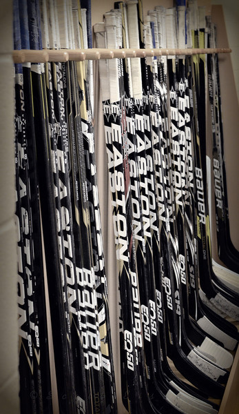 "Hockey Anyone?<br /> <br /> Daily Photos  -  February 10, 2012<br /> <br /> Pick a stick...any stick... This is part of the Stick Prep room in the University of Notre Dame's new Compton Family Ice Arena. The main rink in the facility is named the ""Lefty Smith Rink"", in honor of my wife's grandpa who was the first hockey coach in the program's history. Go Irish!!"