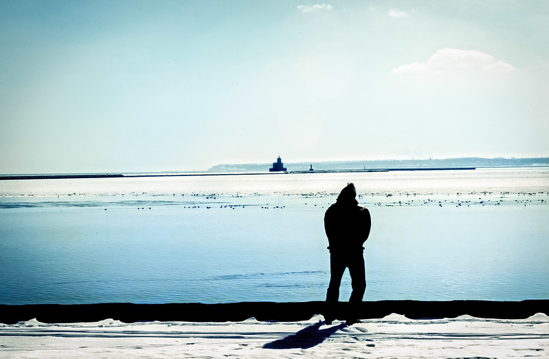 Image of Man at Beach in Winter