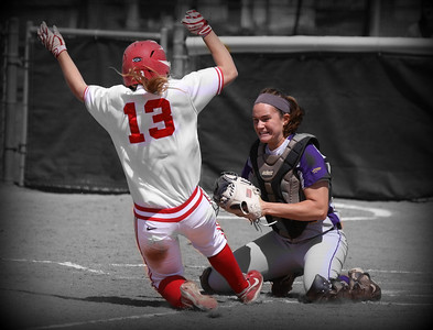 Preparing for the hit.  This is the University of Albany vs University of Boston.  Yes she does place a clean tag and hold the ball for the out. I have been away and have not posted in a few day's.  Have a great day everyone....