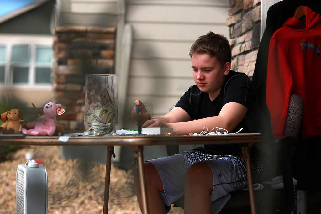 . Dakota Haas is seen through a patio chair as he hosts a yard sale on Sept. 29, 2018 at his home in Berthoud in order to support medial bills from a traumatic brain injury due to an accident he was involved in while riding his bicycle.