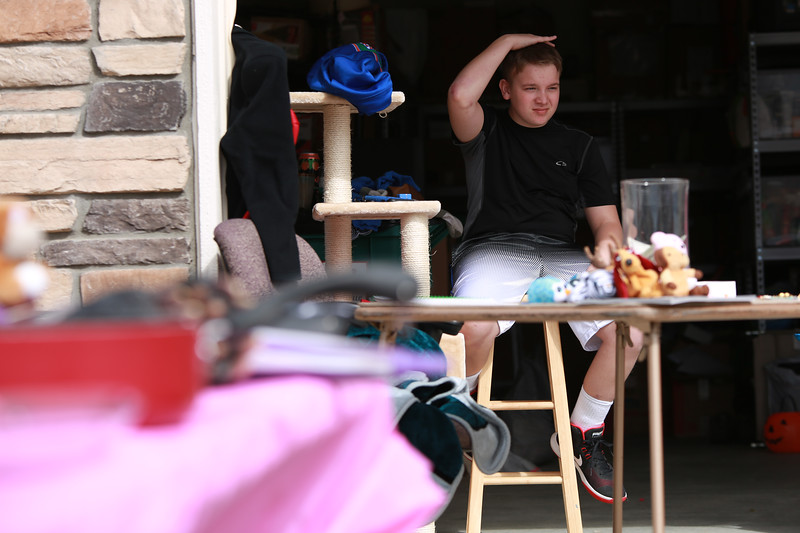 Dakota Haas works the yard sale at his home on in Berthoud on Sept. 29, 2018 that his mother and family are hosting in order to help pay for medical bills from his traumatic brain injury that he recieved after an accident he had invloving an RV. <br /> Photo by Taelyn Livingston/ Loveland REporter-Herald
