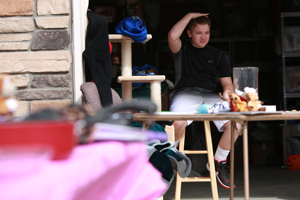 . Dakota Haas works the yard sale at his home on in Berthoud on Sept. 29, 2018 that his mother and family are hosting in order to help pay for medical bills from his traumatic brain injury that he recieved after an accident he had invloving an RV. 