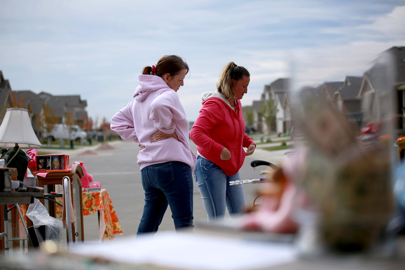 On Sept. 29, 2018, Susan Kaczmarek and her friend, Stacie Drake work a yard sale in Berthoud that they are hosting to raise money Kaczmarek's son, Dakota Haas who is recovering from traumatic brain injury he received from and accident.<br /> Photo by Taelyn Livingston/ Loveland Reporter-Herlad