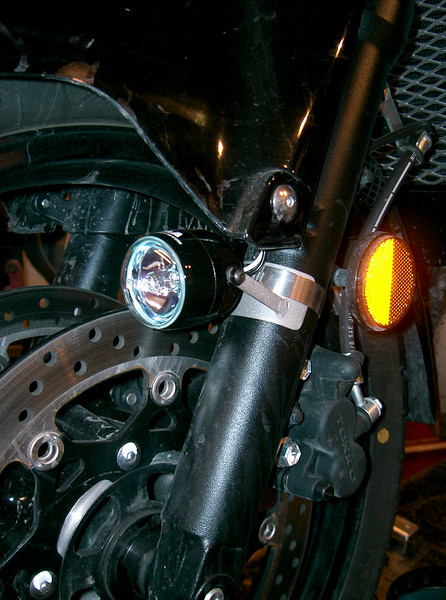 Piaa 002x with hand fabricated stainless steel light mounts. Tucked in close to the fender to keep them out of the way. This light kit comes with two 35 watt Piaa lights with mounts, relay, switch, and wiring harness.  Price $150.00.