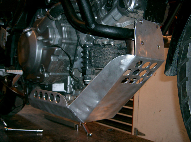 Skidplate on Chad's 650 V-Strom. Hand fabricated and TIG welded from aluminum. Attaches to Givi crash bars in the front and aluminum bracket in the rear. Can be powdercoated for an additional charge. Price: 180.00