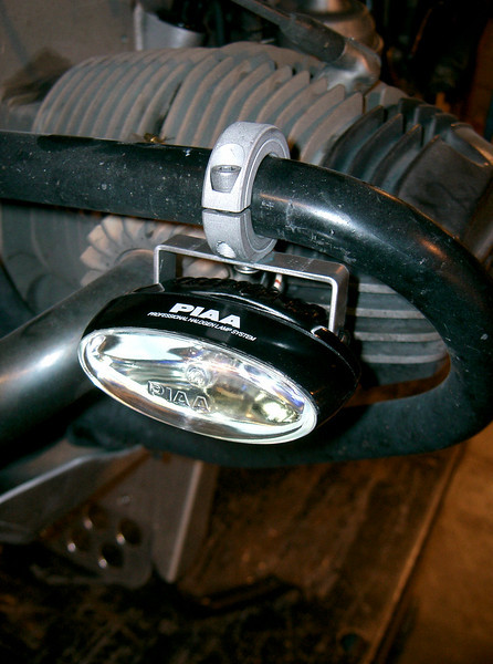 """Piaa 001. All aluminum bracket. Can attach to a 1"""" O.D. crashbar. This light is now absolete. Replaced by the 002."""