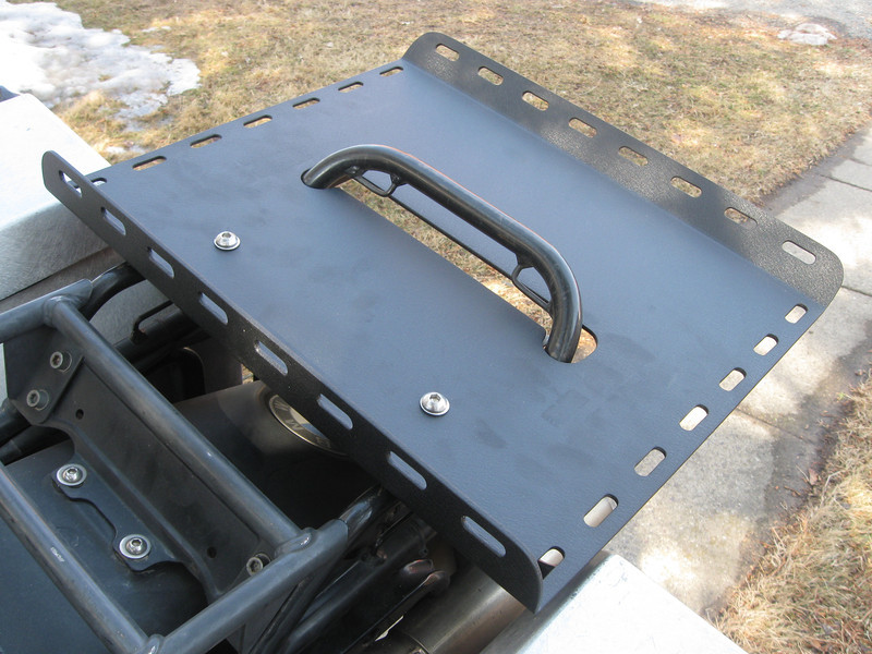 Rear cargo rack on a R100GS. Hand fabricated and TIG welded from aluminum. Comes in a powder coat finish.Works on the solo seat or two up seat. Also works with Jesse saddle bags. Cost is $120.00. To order contact me at: dakotabeemer@hotmail.com