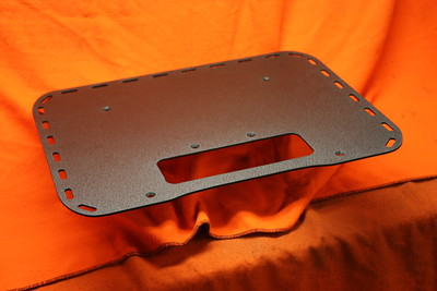 "Rear cargo rack for the second generation KLR650. Hand fabricated from 1/8"" aluminum with a satin black wrinkle powdercoat. Comes with stainless steel countersunk hardware.  Size: 18"" X 14"". Custom size available. Price: $90.00."