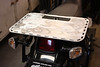 """Rear cargo rack for the second generation KLR650. The deck measures 14"""" X 18"""". Fabricated from 1/8"""" thick aluminum. Comes with stainless stell mounting hardware. Comes in a satin black wrinkle powdercoat. Lots of mounting points for tiedowns. Price. $90.00."""