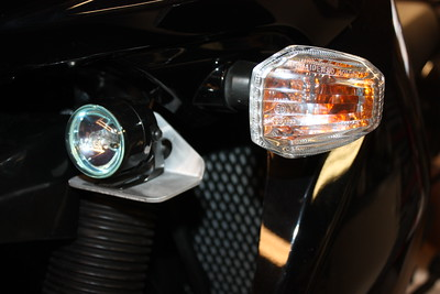 Aux light mount for the second generation KLR650. Smaller aux lights can be mounted on top. Slightly larger lights can be mounted on the underside. The sample light in the picture is a Piaa model 002X. Comes in a stain black powdercoat finish. Cost $50.00 a pair.