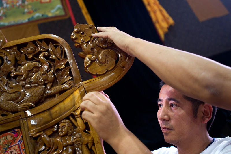 """Sangay Kyab, with the Tibetan Association of Colorado, puts together a chair, as they prepare for the Dalai Lama's visit in the Coors Event Center at CU Boulder on Wednesday.<br /> More photos:  <a href=""""http://www.dailycamera.com"""">http://www.dailycamera.com</a><br /> (Autumn Parry/Staff Photographer)<br /> June 22, 2016"""