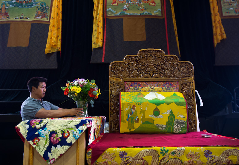 "Amdo Nyima arranges flowers on the stage as he helps the Tibetan Association of Colorado prepare for the Dalai Lama's visit in the Coors Event Center at CU Boulder on Wednesday. <br /> More photos:  <a href=""http://www.dailycamera.com"">http://www.dailycamera.com</a><br /> (Autumn Parry/Staff Photographer)<br /> June 22, 2016"