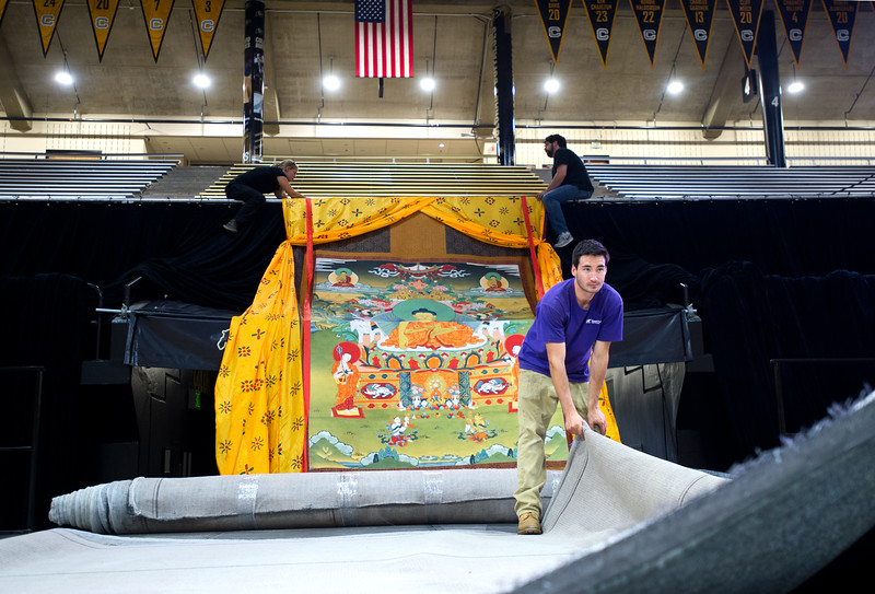 "JC Daily, with RC Special Events, helps lay down carpet on the stage as they prepare for the Dalai Lama's visit in the Coors Event Center at CU Boulder on Wednesday.<br /> More photos:  <a href=""http://www.dailycamera.com"">http://www.dailycamera.com</a><br /> (Autumn Parry/Staff Photographer)<br /> June 22, 2016"