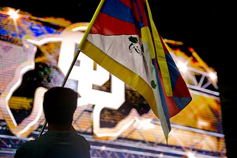"Amdo Nyima hangs a Tibetan flag as he helps prepare for the Dalai Lama's visit in the Coors Event Center at CU Boulder on Wednesday. <br /> More photos:  <a href=""http://www.dailycamera.com"">http://www.dailycamera.com</a><br /> (Autumn Parry/Staff Photographer)<br /> June 22, 2016"