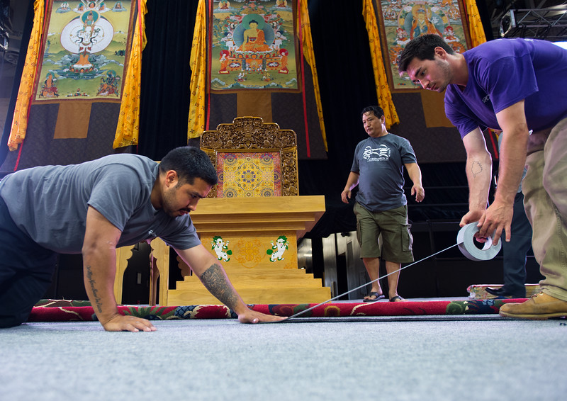 "JC Daily (right), with RC Special Events, helps lay down carpet on the stage as they prepare for the Dalai Lama's visit in the Coors Event Center at CU Boulder on Wednesday.<br /> More photos:  <a href=""http://www.dailycamera.com"">http://www.dailycamera.com</a><br /> (Autumn Parry/Staff Photographer)<br /> June 22, 2016"