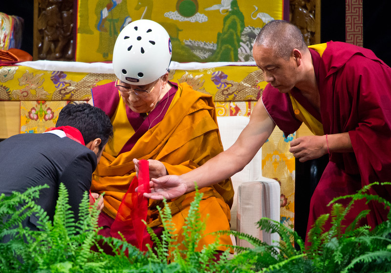 "The Dalai Lama offers a Khata during his morning session in the Coors Event Center at the University of Colorado Boulder on Thursday.<br /> More photos:  <a href=""http://www.dailycamera.com"">http://www.dailycamera.com</a><br /> (Autumn Parry/Staff Photographer)<br /> June 23, 2016"