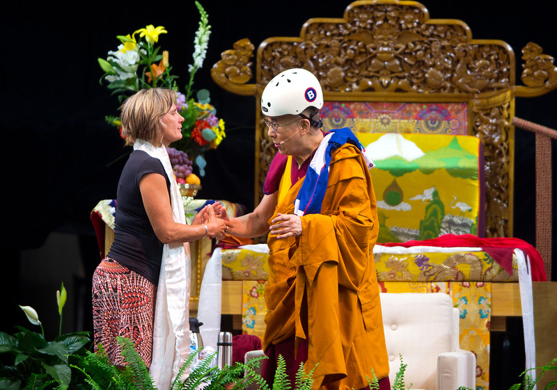 "Boulder Mayor Suzanne Jones shakes hands with the Dalai Lama after she gifted him a helmet during the morning session in the Coors Event Center at the University of Colorado Boulder on Thursday.<br /> More photos:  <a href=""http://www.dailycamera.com"">http://www.dailycamera.com</a><br /> (Autumn Parry/Staff Photographer)<br /> June 23, 2016"