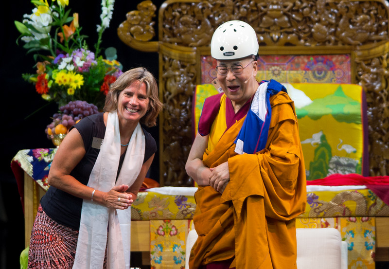 "Boulder Mayor Suzanne Jones shares a laugh with the Dalai Lama after she gifted him a helmet during the morning session in the Coors Event Center at the University of Colorado Boulder on Thursday.<br /> More photos:  <a href=""http://www.dailycamera.com"">http://www.dailycamera.com</a><br /> (Autumn Parry/Staff Photographer)<br /> June 23, 2016"