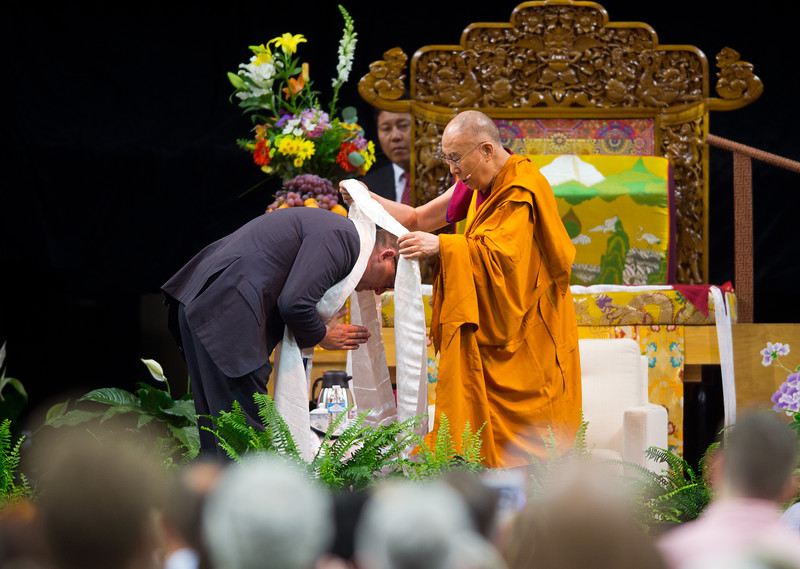 "The Dalai Lama offers a Khata during the morning session in the Coors Event Center at the University of Colorado Boulder on Thursday. During a two-hour morning session, the spiritual leader delivered remarks on ""Eight Verses of Training the Mind"" to members of the public.<br /> More photos:  <a href=""http://www.dailycamera.com"">http://www.dailycamera.com</a><br /> (Autumn Parry/Staff Photographer)<br /> June 23, 2016"
