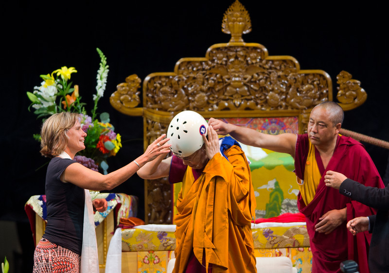 "Boulder Mayor Suzanne Jones helps the Dalai Lama adjust a helmet that she gifted him during the morning session in the Coors Event Center at the University of Colorado Boulder on Thursday.<br /> More photos:  <a href=""http://www.dailycamera.com"">http://www.dailycamera.com</a><br /> (Autumn Parry/Staff Photographer)<br /> June 23, 2016"