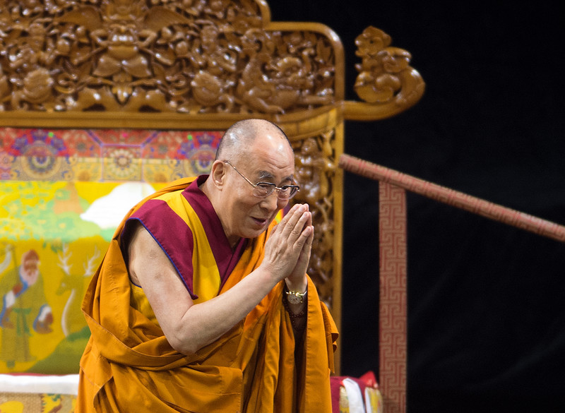 "The Dalai Lama greets the audience during the morning session in the Coors Event Center at the University of Colorado Boulder on Thursday. During a two-hour morning session, the spiritual leader delivered remarks on ""Eight Verses of Training the Mind"" to members of the public.<br /> More photos:  <a href=""http://www.dailycamera.com"">http://www.dailycamera.com</a><br /> (Autumn Parry/Staff Photographer)<br /> June 23, 2016"