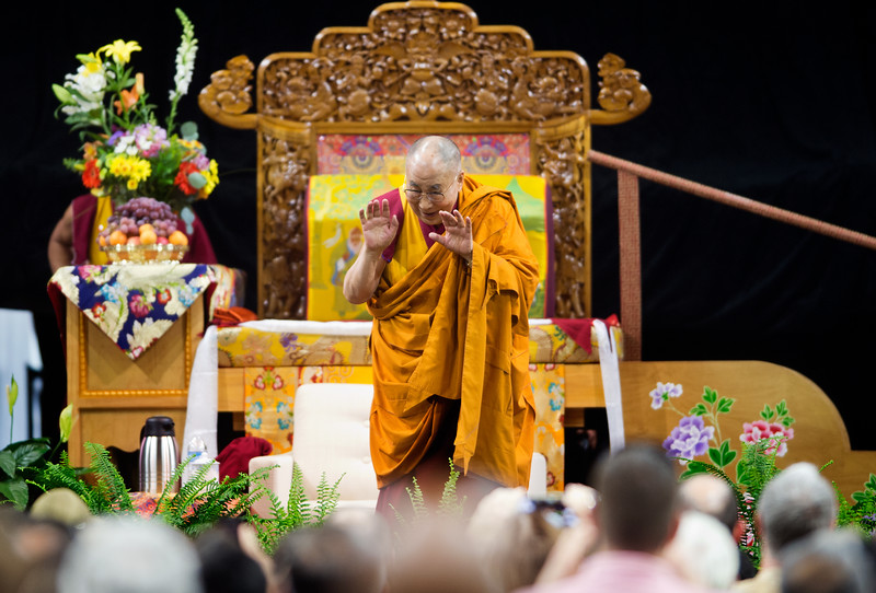 """The Dalai Lama greets the crowd during the morning session in the Coors Event Center at the University of Colorado Boulder on Thursday. During a two-hour morning session, the spiritual leader delivered remarks on """"Eight Verses of Training the Mind"""" to members of the public.<br /> More photos:  <a href=""""http://www.dailycamera.com"""">http://www.dailycamera.com</a><br /> (Autumn Parry/Staff Photographer)<br /> June 23, 2016"""