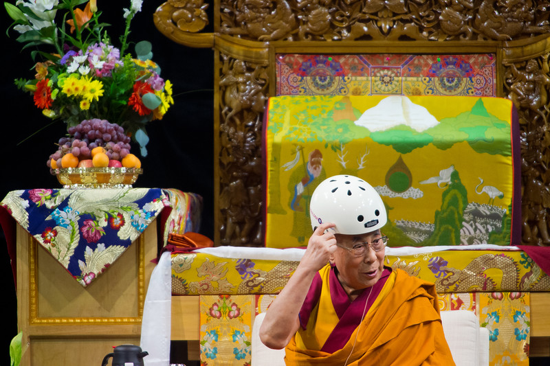 "The Dalai Lama points to a helmet gifted by Boulder Mayor Suzanne Jones during the morning session in the Coors Event Center at the University of Colorado Boulder on Thursday. <br /> More photos:  <a href=""http://www.dailycamera.com"">http://www.dailycamera.com</a><br /> (Autumn Parry/Staff Photographer)<br /> June 23, 2016"