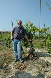 "Paolo Saracco and one of his 70 yrs old moscato vines.  Dalla Terra ""Giro d'Italia"" Tour June 2005"