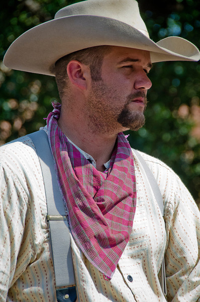 Handsome cattle driver at the daily 4pm cattle drive at the Stockyards, Fort Worth, Texas. 3 May 2012.