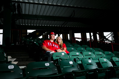 Denise and Jonathan's Texas Rangers engagement session photos. Engagement pictures at the Ballpark in Arlington. Globelife baseball engagement photography, Arlington engagement photographer. Fort Worth wedding photographer, 2015 summer wedding, wedding at The Orchard. Baseball themed engagement session. Monica Salazar Photography, http://www.monica-salazar.com