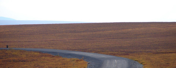 9/1/07 - The one stop I made for photos on the way back south.  Mark disappearing around the bend as he continues toward North Pole.  Just a few miles later he pulled off to take a photo or two of his own, but first passed up a herd of muskox bedded down on the tundra.