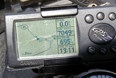 7/29/04 2:11 PM - The display on the GPS shows my location in the previous photo relative to the beginning of the Haul Road, as well as the distance traveled from my fill-up in Key West 23 days earlier.