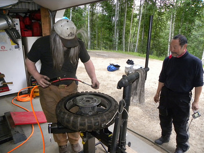 Dan Armstrong airing up Dean's rear tire, getting the 'Strom ready to tackle the Dalton Hwy.