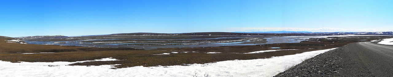 The Sag (Sagavanirktok) River, shortly after break-up, with large chunks of ice still flowing downstream, toward the Arctic Ocean. As with most panoramic photos, this needs to be viewed at original size and scrolled across for the full visual effect.