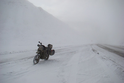 9/22/08 12:07 PM - This was looking back to the south, whence I had just come.  A grader was working the top 1/3 of this side, trying to keep the drifts from building up.  Wonder what his thoughts were as I climbed past him, rear tire spinning occasionally, headed for the top??