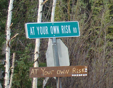 Hmmm.  This tells it all.  A road sign off the Elliott Hwy, just prior to Olnes City (pop. 1).