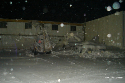 12/25/07  9:36 - Equipment parked all over Deadhorse suffered the same fate - if it sat still for more than a day or two, it soon became so plastered with blowing snow that it became almost unrecognizable.  So it was with this truck and backhoe.