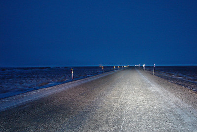 12/25/07 10:42 - Finally out of Deadhorse and a few miles south on the Haul Road, the sky to the south is becoming lighter, but the driving lights are still necessary to illuminate the constantly-changing road surface, and the eyes of any animals straying too close to this avenue.