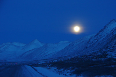 12/24/07 15:17 (3:17 PM for the mathematically challenged) - For a few days the moon never set or rose in the far northern latitudes, as this photo looking north northeast up the Atigun valley illustrates.  This was approximately 110 miles north of the Arctic Circle.