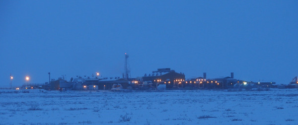 12/25/07 12:21 - Adding its push to get the crude oil over the Brooks Range mountains, Pump 3 appears as a brightly lit oasis in the midst of this vast Arctic plain.
