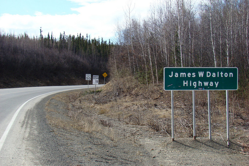 Mile 0, and the beginning of the Dalton Highway - the Haul Road. N65.48941, W148.65469,  Elevation: 624'  82.5 miles from the gas pumps at the Fred Meyer store on Airport Way.