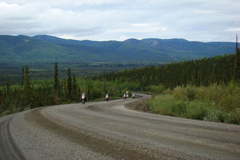8/8/08 10:35AM: Almost immediately upon joining the Dalton Hwy, a climb that can offer a challenge to bikes after a day of rain.  This day it was dry and nicely graded, just a little loose gravel away from the tire tracks.