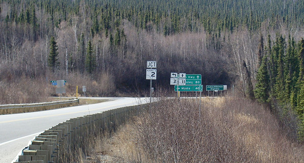 Approaching the beginning of the Dalton Hwy, the plethora of signage can easily translate into information overload.  The Elliott Hwy. continues to the left toward Manley Hot Springs as AK-2, and the Dalton Hwy. begins here designated AK-11, as one continues northward on the pavement, which quickly ends.