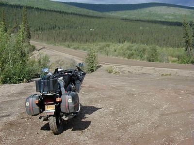7/29/04 2:10 PM - At Lost Creek, just a few miles after the beginning of the Haul Road, I stop to double-check the bike, making sure everything is fastened securely in anticipation of the bumps and washboard to come.
