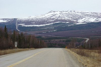 Looking back south from the entrance to the BLM Arctic Circle wayside at around Mile 115, Beaver Slide is visible as a vertical line ascending to the top of the ridge on the horizon.