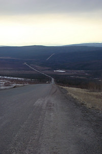 "MP110 looking north.  The Arctic Circle wayside is just before the highest visible portion of the highway on the distant hill, some 5 more miles by road.  This point is just below the beginning of the gravel hill known as ""Beaver Slide"" which descends over a mile to the valley floor."
