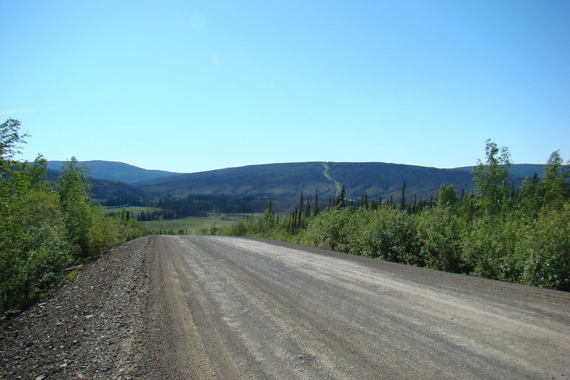 7/4/08 10:26AM:  Just above 25 Mile Corner, looking back southeast.  The twisting clearing on the far hill is the pipeline's route through the boreal forest.
