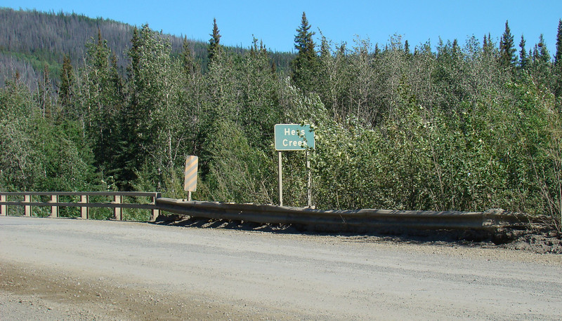 Hess Creek at Mile 23.9. As you approach it from either direction, it is well hidden by brush and trees and easily ignored.  But a glance up or down stream reveals a scenic waterway - the largest stream between MP0 and the Yukon River.  A primitive campground can be found on the far side, with good fishing available. N65.66512, W149.09625, Elevation: 518'