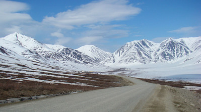 Taken from Mile 237.6, this shot looks toward Atigun Pass, and a portion of the road climbing to the summit can be seen in the center of the photo.  The buildings of the DOT Chandalar camp can be seen just to the left of center.